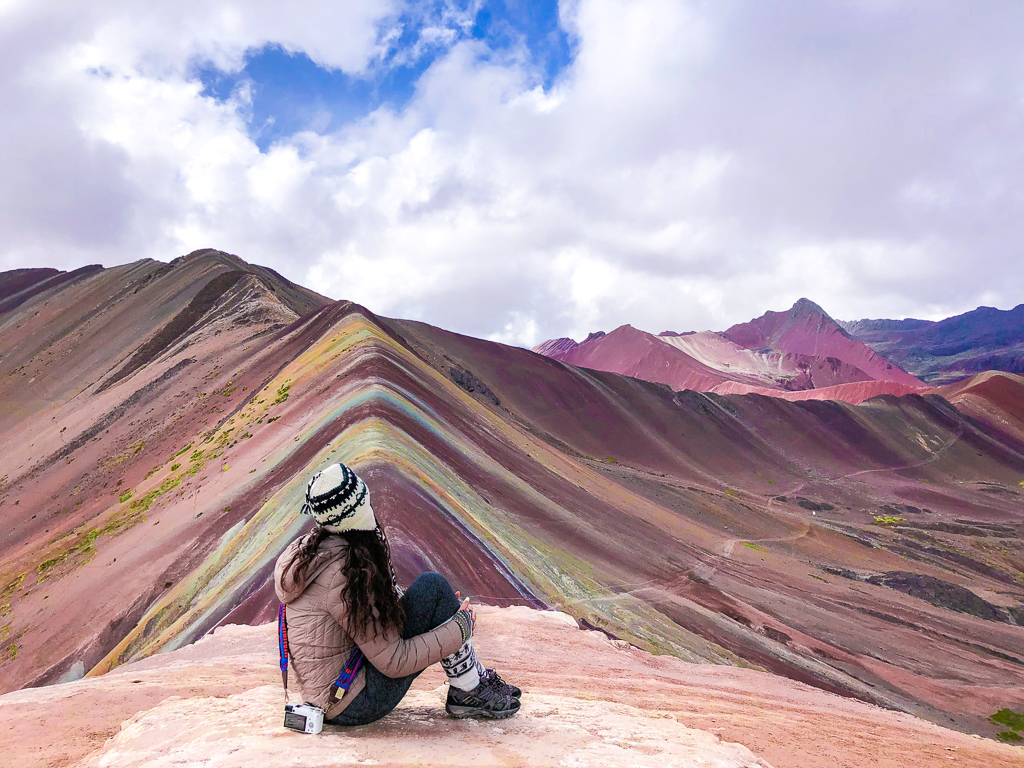 Our product manager Aashima, taking in a rainbow view of the Peruvian Andes