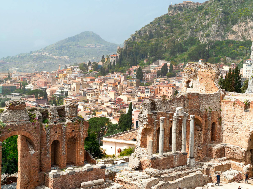 The Sicilian city of Taormina, as viewed from its Greco-Roman ruins.